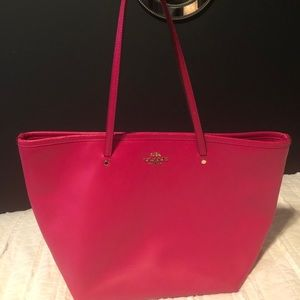 Bright pink leather coach purse